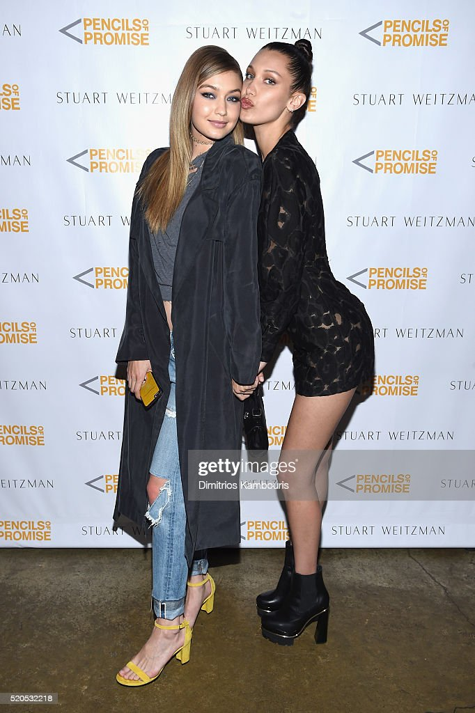 Model Gigi Hadid (L) and Bella Hadid attend as Stuart Weitzman launches its partnership with Pencils Of Promise at Sadelle's on April 11, 2016 in New York City.