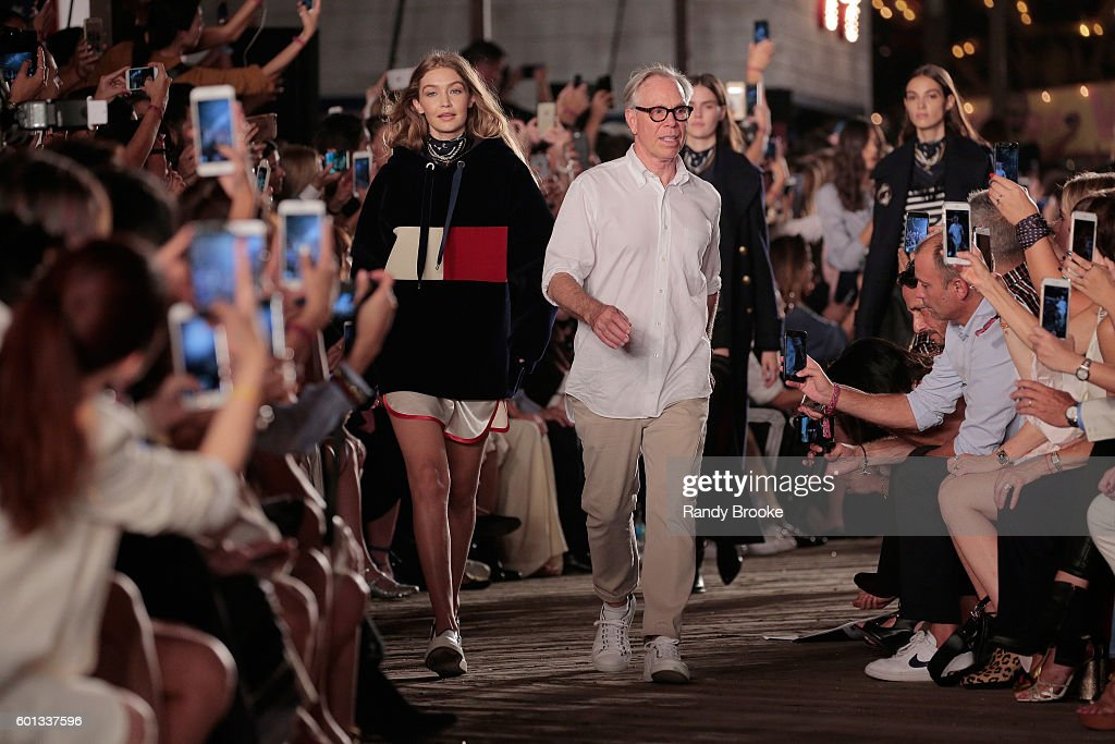 Model Gigi Hadid (L) and designer Tommy Hilfiger walk the runway at #TOMMYNOW Women's Fashion Show during New York Fashion Week at Pier 16 on September 9, 2016 in New York City.