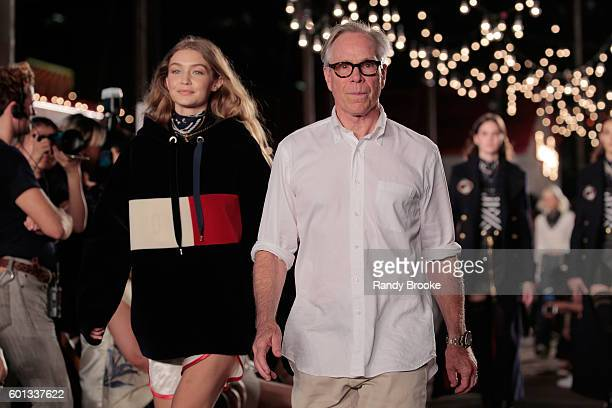Model Gigi Hadid and designer Tommy Hilfiger walk the runway at #TOMMYNOW Women's Fashion Show during New York Fashion Week at Pier 16 on September 9...