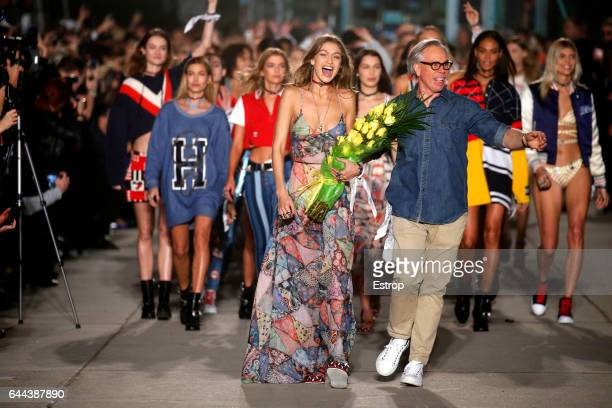 Model Gigi Hadid and Designer Tommy Hilfiger walking the runway at the Tommy Hilfiger show during the New York Fashion Week February 2017 collections...