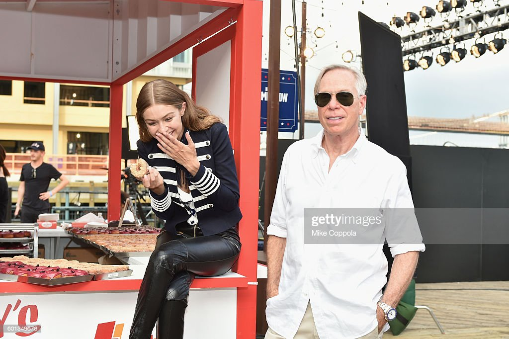 Model Gigi Hadid and fashion designer Tommy Hilfiger attend the #TOMMYNOW Women's Fashion Show during New York Fashion Week at Pier 16 on September 9, 2016 in New York City.
