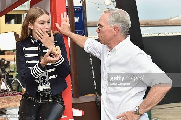 Model Gigi Hadid and fashion designer Tommy Hilfiger attend the #TOMMYNOW Women's Fashion Show during New York Fashion Week at Pier 16 on September 9...