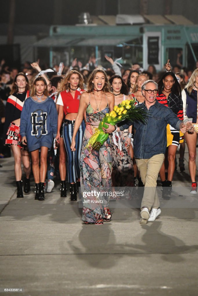 Model Gigi Hadid (L) and fashion designer Tommy Hilfiger (R) walk the runway at the TommyLand Tommy Hilfiger Spring 2017 Fashion Show on February 8, 2017 in Venice, California.