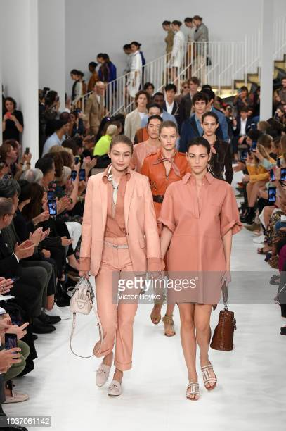 Model Gigi Hadid and Vittoria Ceretti walk the runway at the Tod's show during Milan Fashion Week Spring/Summer 2019 on September 21, 2018 in Milan,...