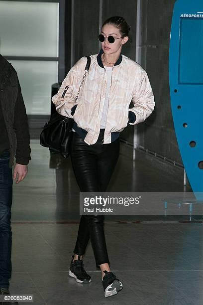 Model Gigi Hadid arrives at Aeroport Roissy Charles de Gaulle on November 27 2016 in Paris France