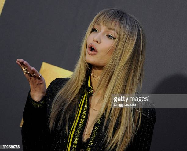Model Gigi Hadid arrives at the 2016 MTV Movie Awards at Warner Bros Studios on April 9 2016 in Burbank California