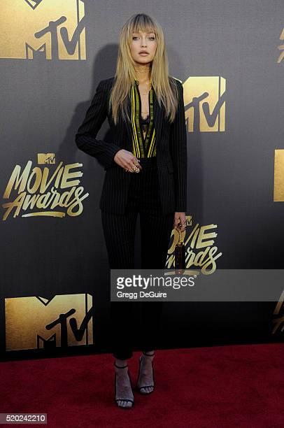 Model Gigi Hadid arrives at the 2016 MTV Movie Awards at Warner Bros Studios on April 9 2016 in Burbank California