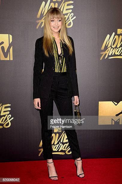 Model Gigi Hadid attends the 2016 MTV Movie Awards at Warner Bros Studios on April 9 2016 in Burbank California MTV Movie Awards airs April 10 2016...