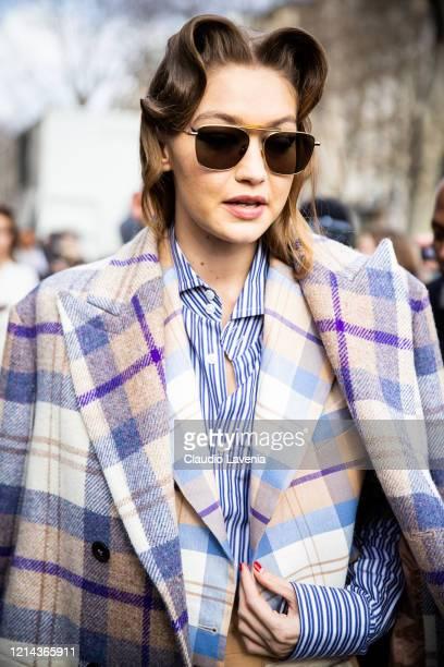 Model Gigi Hadid beauty detail is seen outside Miu Miu during Paris Fashion Week Womenswear Fall/Winter 2020/2021 Day Nine on March 03 2020 in Paris...