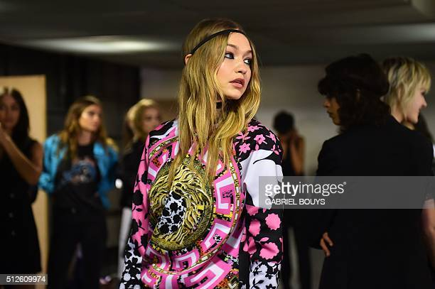 Model Gigi Hadid is pictured backstage before the show for fashion house Versace as part of the Women Autumn / Winter 2016 Milan Fashion Week on...