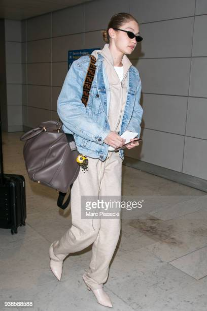 Model Gigi Hadid is seen at CharlesdeGaulle airport on March 27 2018 in Paris France