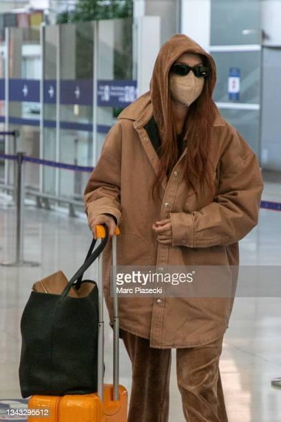 Model Gigi Hadid is seen at Charles-de-Gaulle airport on September 27, 2021 in Paris, France.