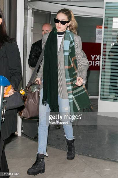 Model Gigi Hadid is seen at CharlesdeGaulle airpport on March 4 2018 in Paris France
