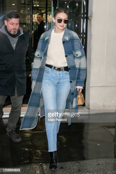 Model Gigi Hadid is seen leaving the CHANEL office building on March 01, 2020 in Paris, France.