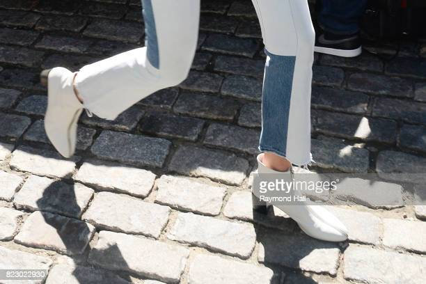 Model Gigi Hadid jenas and boot detail is seen walking in Soho on July 26 2017 in New York City