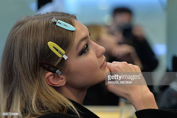 US model Gigi Hadid looks on backstage before the Atelier Versace show during the Haute Couture SpringSummer 2016 in Paris on January 24 2016 AFP...