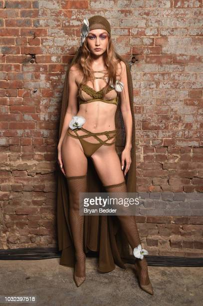 Model Gigi Hadid poses backstage for the Savage X Fenty Fall/Winter 2018 fashion show during NYFW at the Brooklyn Navy Yard on September 12 2018 in...