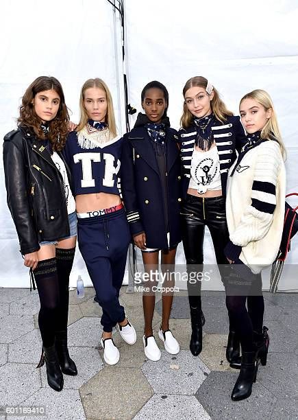 Model Gigi Hadid poses with models backstage at the #TOMMYNOW Women's Fashion Show during New York Fashion Week at Pier 16 on September 9 2016 in New...