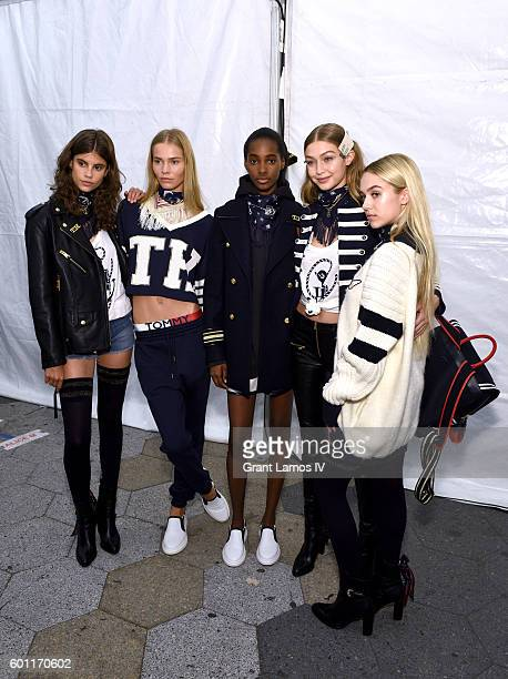 Model Gigi Hadid poses with models backstage at the #TOMMYNOW Women's Fashion Show during New York Fashion Week at Pier 16 on September 9, 2016 in...