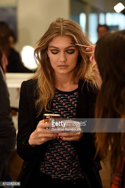 Model Gigi Hadid prepares backstage at the Diane Von Furstenberg Fall 2016 show during New York Fashion Week on February 14 2016 in New York City