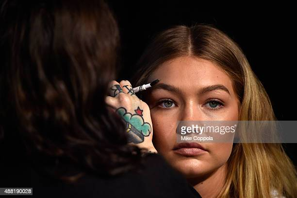 Model Gigi Hadid prepares backstage at Tommy Hilfiger Women's Spring 2016 during New York Fashion Week The Shows at Pier 36 on September 14 2015 in...