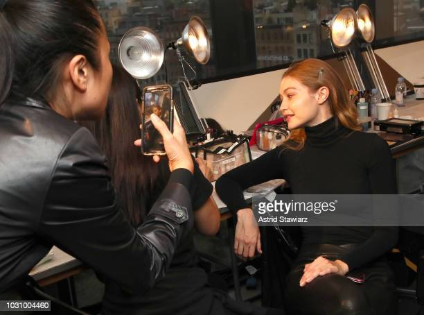 Model Gigi Hadid prepares backstage for the Anna Sui show during New York Fashion Week The Shows at Gallery I at Spring Studios on September 10 2018...