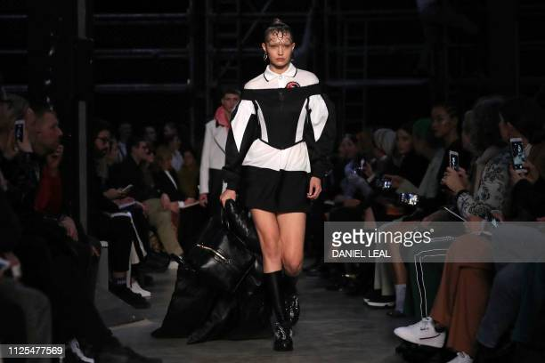 Model Gigi Hadid presents a creation during the British fashion house Burberry 2019 Autumn / Winter collection catwalk show at London Fashion Week in...