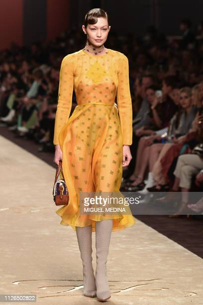 Model Gigi Hadid presents a creation during the Fendi women's Fall/Winter 2019/2020 collection fashion show on February 21 2019 in Milan