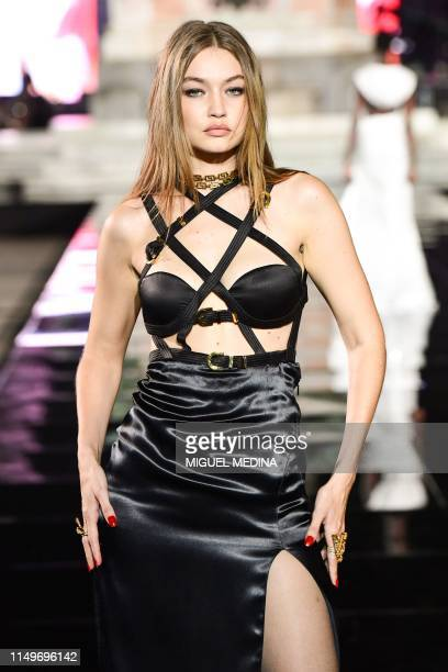 US model Gigi Hadid presents a creation during the presentation of French fashion editor Carine Roitfeld's CR Runway concept with Italian luxury...