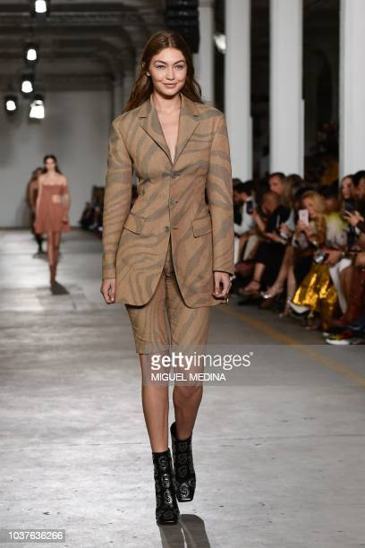 Model Gigi Hadid presents a creation during the presentation of the Roberto Cavalli fashion show as part of the Women's Spring/Summer 2019 fashion...
