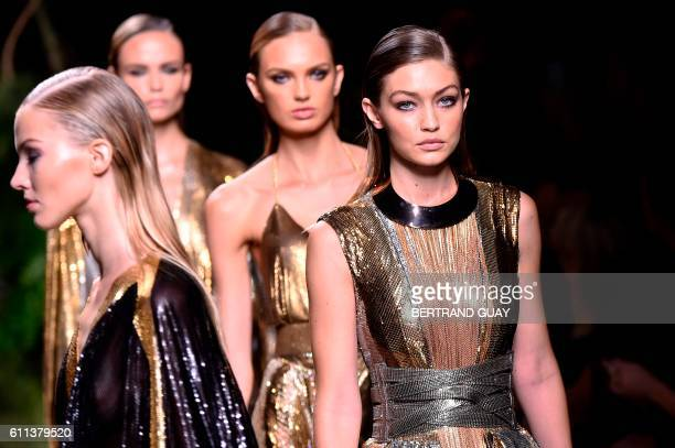 TOPSHOT US model Gigi Hadid presents a creation for Balmain during the 2017 Spring/Summer readytowear collection fashion show on September 29 2016 in...