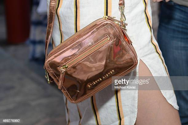 Model Gigi Hadid purse detail during the Official HM Loves Coachella Party at the Parker Palm Springs on April 10 2015 in Palm Springs California