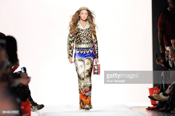 Model Gigi Hadid walks on the runway with nails by CND for Jeremy Scott Fall/Winter 2017 on February 10, 2017 in New York City.