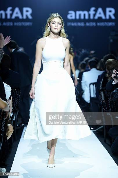Model Gigi Hadid walks the runway at amfAR's 22nd Cinema Against AIDS Gala Presented By Bold Films And Harry Winston at Hotel du CapEdenRoc on May 21...