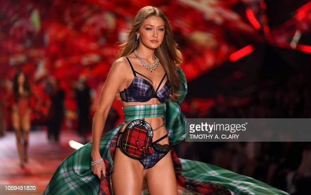 US model Gigi Hadid walks the runway at the 2018 Victoria's Secret Fashion Show on November 8 2018 at Pier 94 in New York City Every year the...