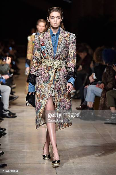 Model Gigi Hadid walks the runway at the Miu Miu Autumn Winter 2016 fashion show during Paris Fashion Week on March 9 2016 in Paris France