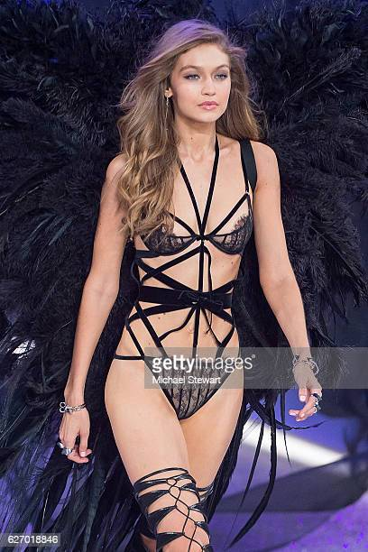 Model Gigi Hadid walks the runway during the 2016 Victoria's Secret Fashion Show at Le Grand Palais in Paris on November 30 2016 in Paris France