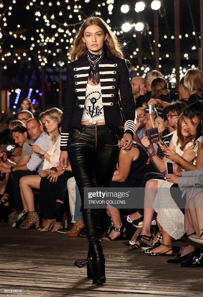 Model Gigi Hadid walks the runway during the Tommy Hilfiger fall 2016 collection presented at New York Fashion Week in New York, September 9, 2016. / AFP / TREVOR