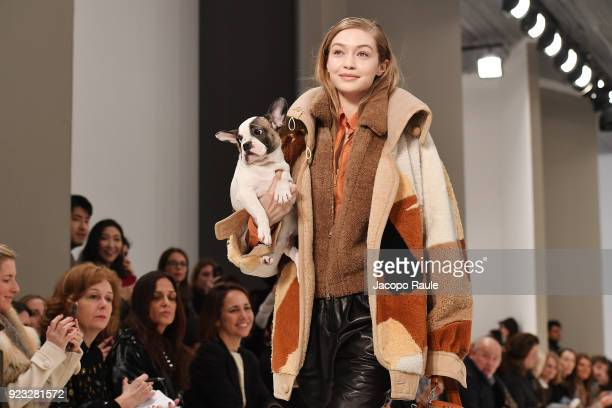 Model Gigi Hadid walks the runway with a dog at the Tod's show during Milan Fashion Week Fall/Winter 2018/19 on February 23, 2018 in Milan, Italy.