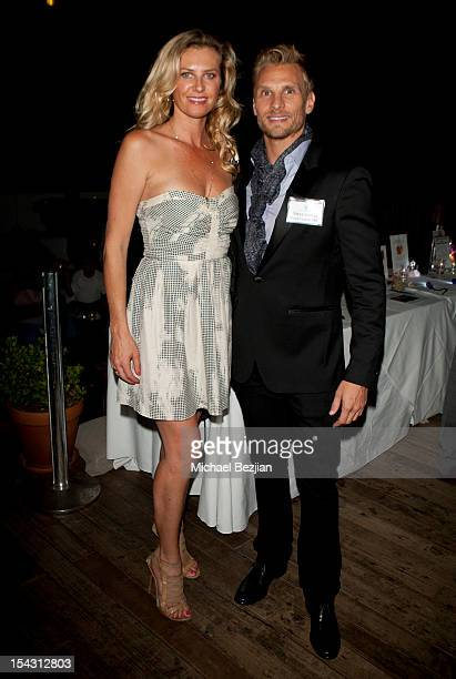 Model Gina Clarke and host Steve Jordan attend Exceptional Children's Foundation Fundraising Gala at SkyBar at the Mondrian Los Angeles on October...