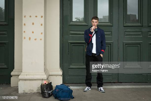 Model Gio Henri poses outside the Royal Exhibition Building on March 13 2020 in Melbourne Australia Melbourne Fashion Festival organisers announced...