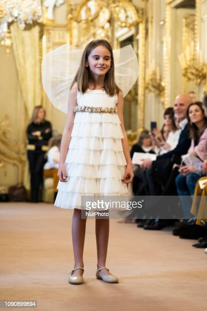 A model girl takes to de catwalk with creations of CharHadas of the The Petite Special Day Fashion Week Madrid in Madrid Spain 29 January 2019