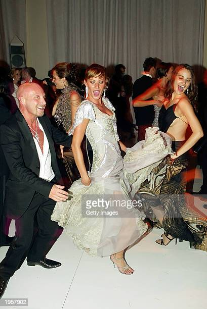 Model Gisele Bundchen and designer Domenico Dolce dance during the Costume Institute Benefit Gala sponsored by Gucci April 28 2003 at The...