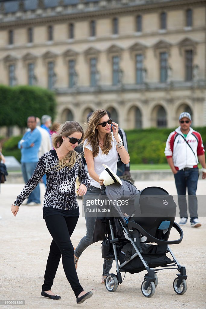 Model Gisele Bundchen (R) and her sister Rafaela Bundchen (L) are sighted in the 'Tuileries' gardens on June 20, 2013 in Paris, France.