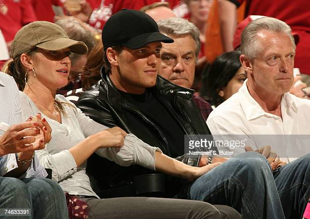 Model Gisele Bundchen and New England Patriots quarterback Tom Brady sit courtside for Game Four of the NBA Finals between the Cleveland Cavaliers...