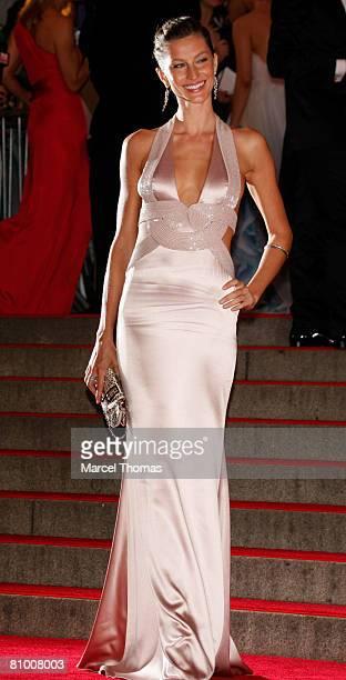 Model Gisele Bundchen attends the Metropolitan Museum of Art Costume Institute Gala 'Superheroes Fashion Fantasy' at the Metropolitan Museum of Art...