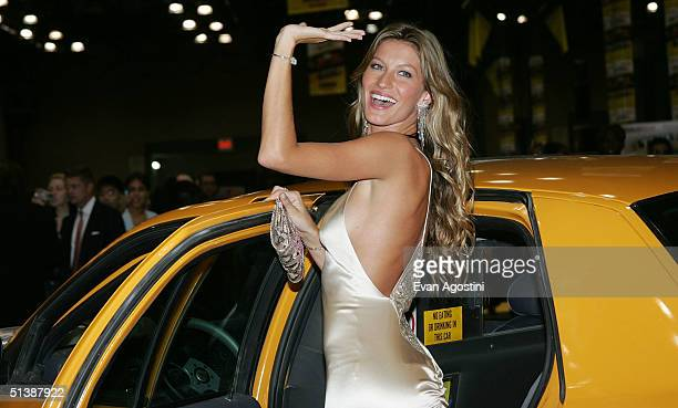 Model Gisele Bundchen attends the Taxi film premiere featuring a Taxi Cab DriveIn at the Jacob Javits Center October 3 2004 in New York City