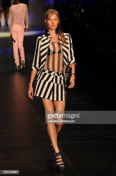 Model Gisele Bundchen displays a design by Colcci during the fifth day of the Sao Paulo Fashion Week Summer 2011 at the Ibirapuera's Bienal pavillion...