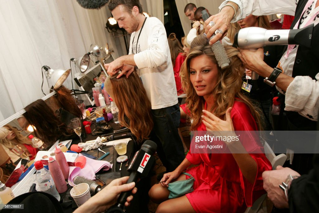 Model Gisele Bundchen is interviewed as she prepares backstage for The Victoria's Secret Fashion Show at the 69th Regiment Armory November 9, 2005 in New York City.