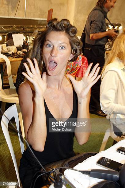 Model Gisele Bundchen prepares backstage for the Christian Dior Fashion show during Paris Haute Couture Fashion Week Fall/Winter 200708 at...